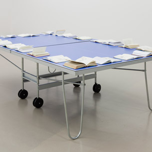 Ciprian Muresan, The Second Invasion from Mars, 2010. 21 books and ping pong table, dimensions variable. Photo credit: CURATOR, ALTEFABRIK Rapperswil  					Courtesy Plan B Cluj/Berlin
